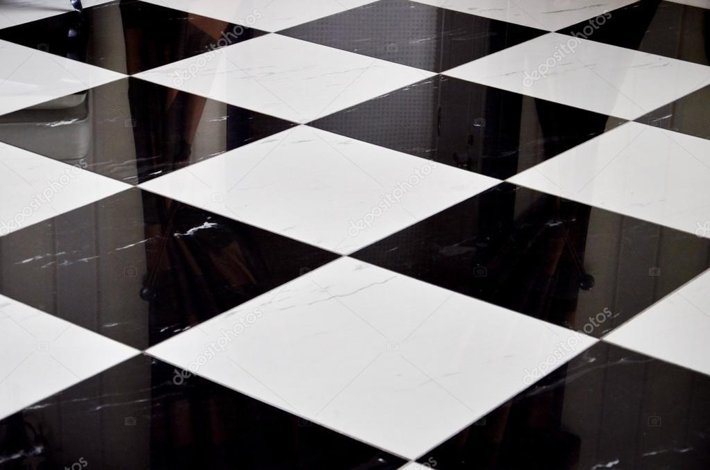 Sfondo di piastrelle bianche e nere u foto stock vivairina