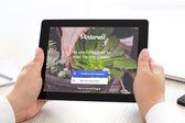 IPad with app Pinterest in the hands of men