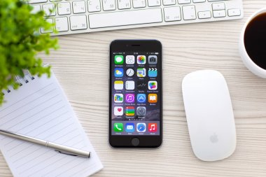 Alushta - October 25, 2014: New phone iPhone 6 Space Gray with apps on screen lies on the table. iPhone 6 was created and developed by the Apple inc.