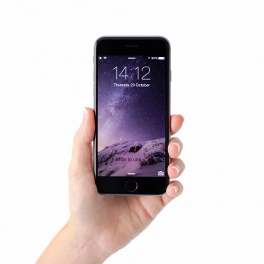 Alushta - October 23, 2014: Woman hand holding iPhone 6 Space Gray with unlock on the screen. iPhone 6 was created and developed by the Apple inc.