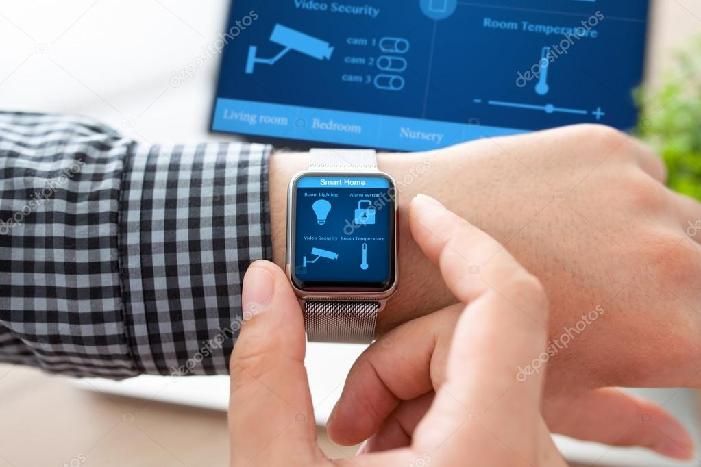 man hand in watch with smart home and computer