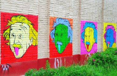 Portrait of Einstein on the wall.