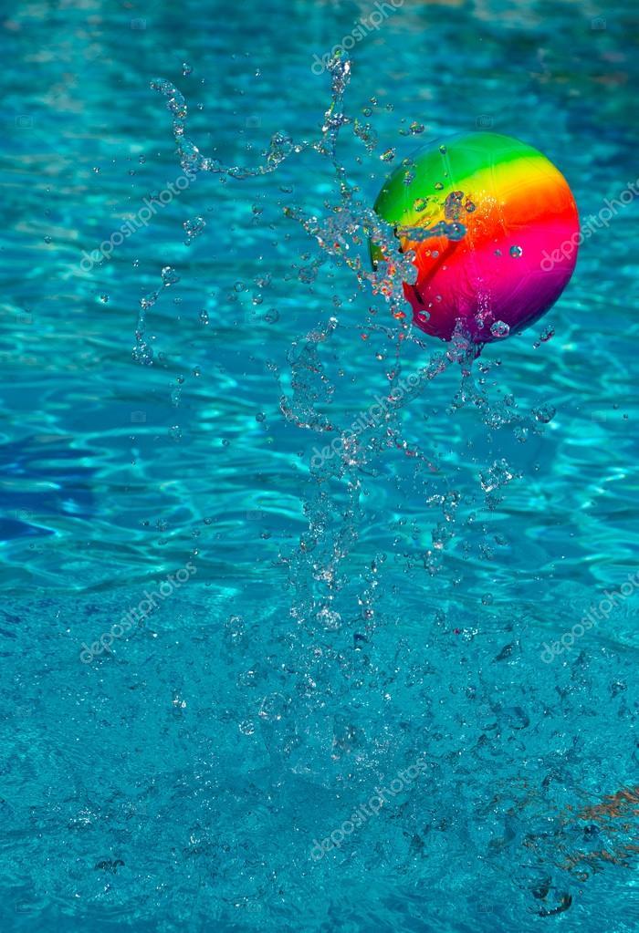 Beach Ball In Water beach ball splashing water in pool — stock photo © bertys30 #118920954