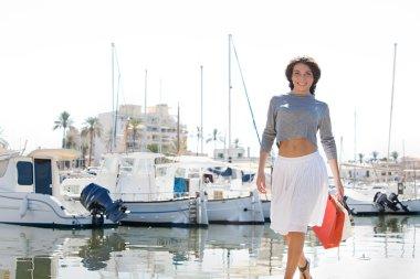 Woman on yachts marine pier