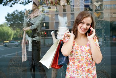 Attractive woman shopping with smartphone