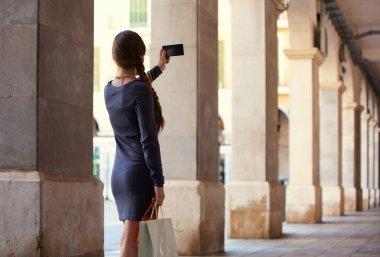 elegant woman using smartphone