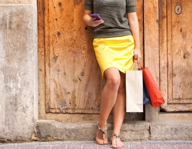 Woman with shopping bags and smartphone