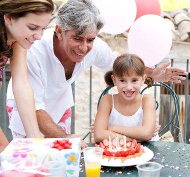 family celebrating a girl child birthday