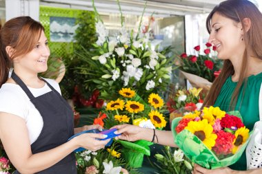 woman buys a bouquet of flowers