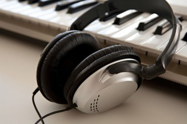pair of headphones and a keyboard