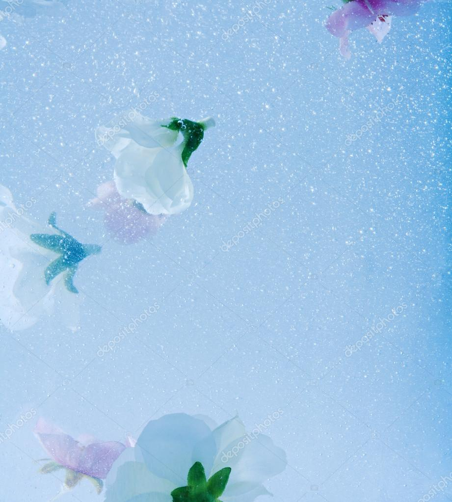bubbles and liquid water with white and pink flowers submerging under water