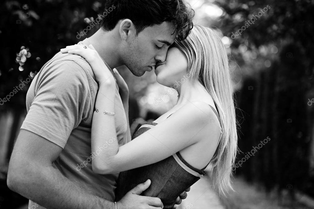 Romantic Young Couple Kissing And Embracing Stock Photo C Mjth