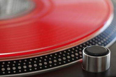 red vinyl album on a professional dj turntable