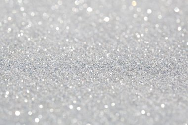 Close up detail view of silver glitter background shining and reflecting light and showing stars. Full frame glitter texture. Party, celebration, abstract and festive background textures. stock vector