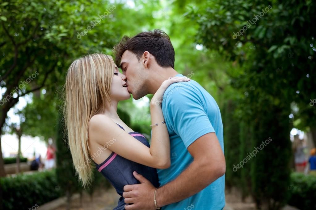Romantic young couple kissing and embracing Stock Photo by ©mjth 79460580
