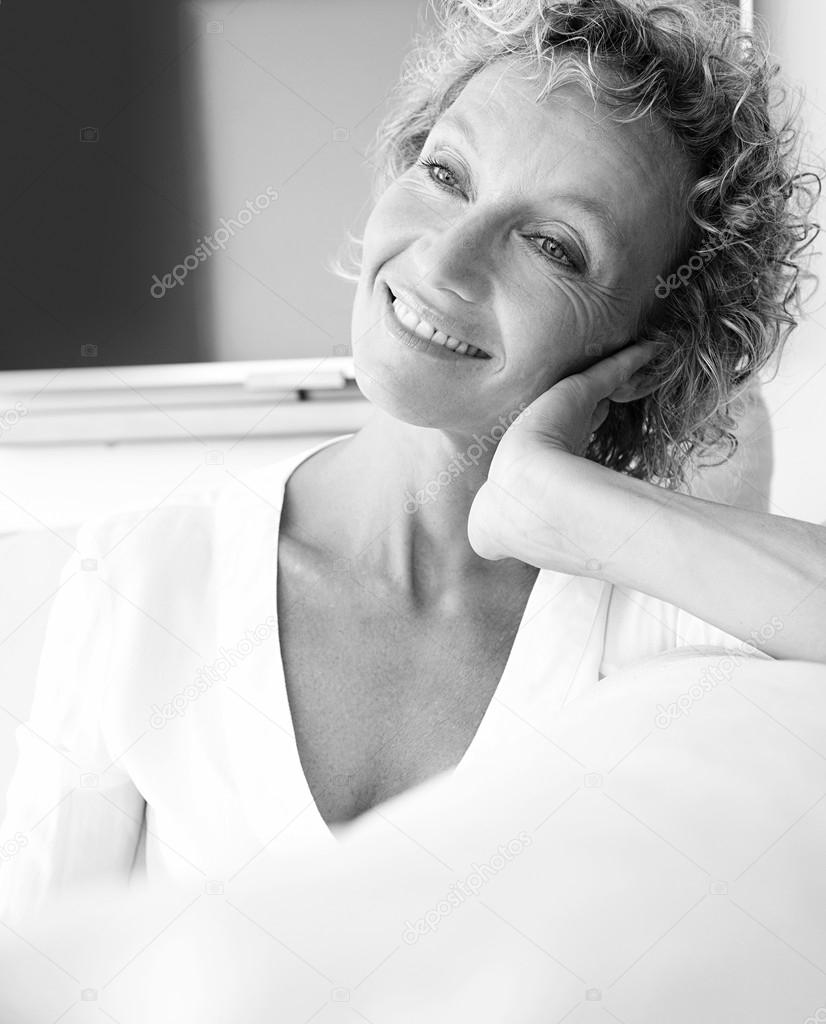 Portrait of mature woman relaxing at home