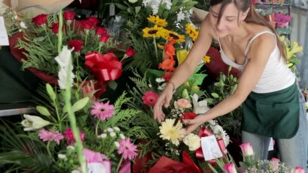woman working and preparing flower arrangements in her shop