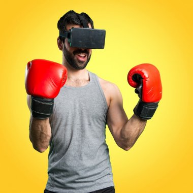 Sportman with boxing gloves and VR glasses