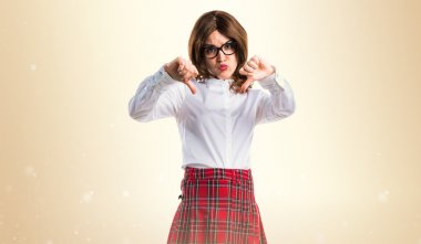 Teen student girl doing bad signal