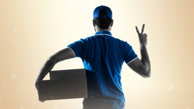 Delivery man doing victory gesture