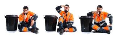 Garbage man making smelling bad gesture