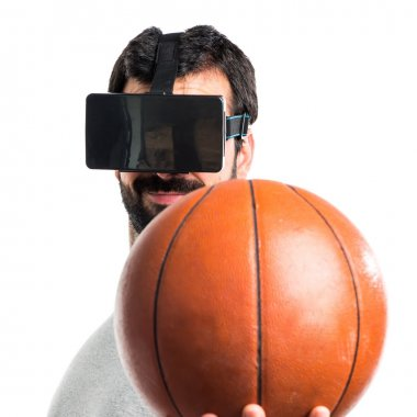 Man playing basketball using VR glasses