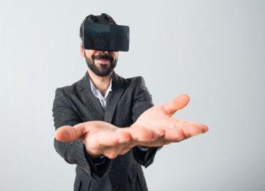 Man using VR glasses holding something