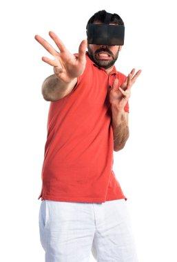 Frightened man using VR glasses