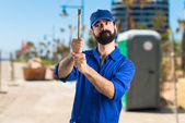 Photo Plumber holding a hammer