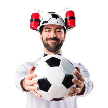 Crazy waiter holding a soccer ball