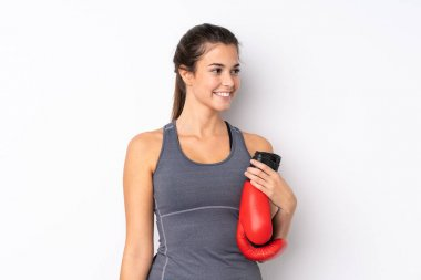 Teenager Brazilian sport girl over isolated white background with boxing gloves