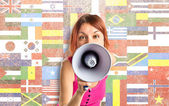 Photo Redhead girl shouting with a megaphone over white background