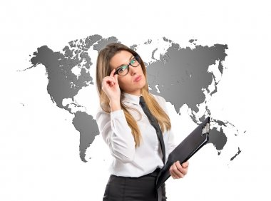 Businesswoman over map background