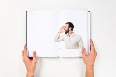 Young man screaming printed on book