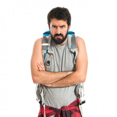 Angry backpacker over isolated white background