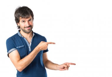 Man pointing over white background