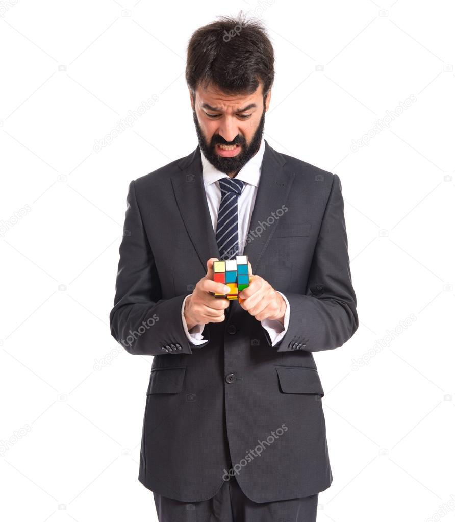 Businessman playing an intelligence game over white backgrpund