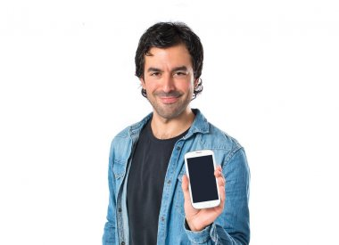 Man showing his mobile over white background