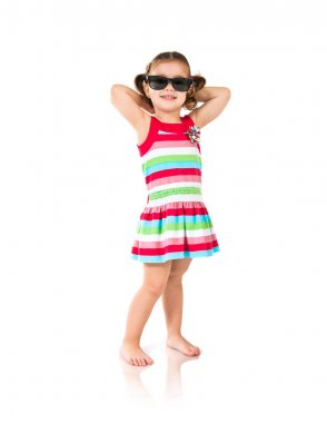 Kid holding sun glasses over white background