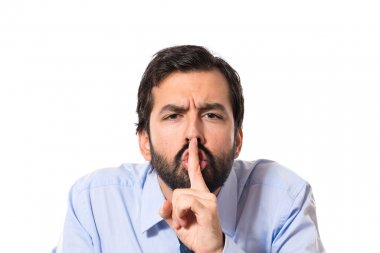 Businessman making silence gesture