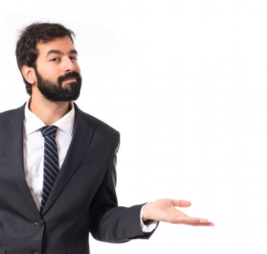 Businessman having doubts over isolated white background