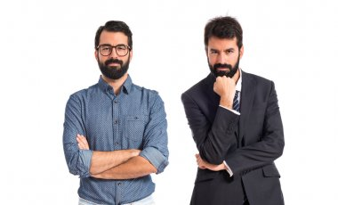 Twin brothers thinking over isolated white background
