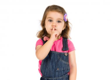 Kid making silence gesture over white background