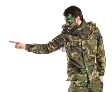 Soldier shouting over white background