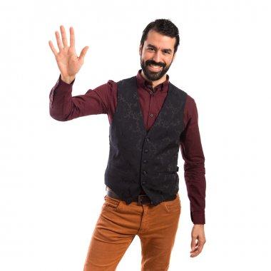 Man wearing waistcoat saluting