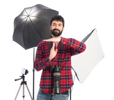 Photographer making time out gesture