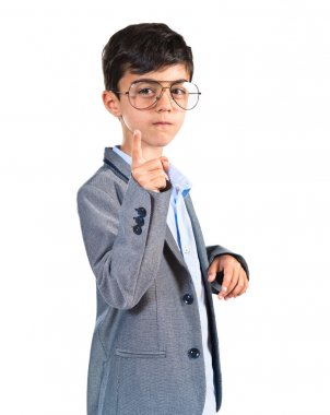Child with vintage glasses pointing to the front