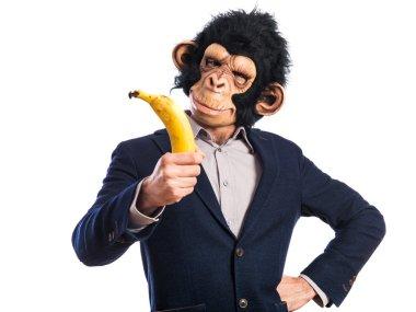 Monkey man holding a banana