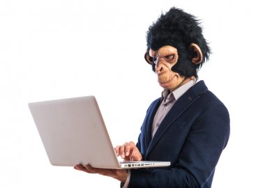 Monkey man with laptop over white background