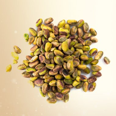 Dried fruits over ocher background